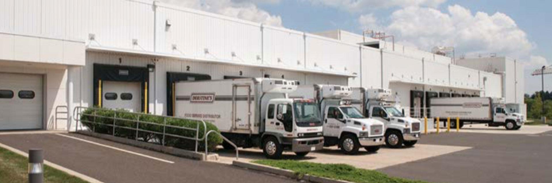 Trucks outside the Derstine's building