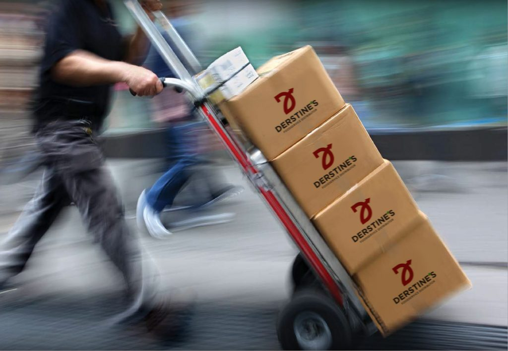 A hand truck with boxes labelled Derstine's