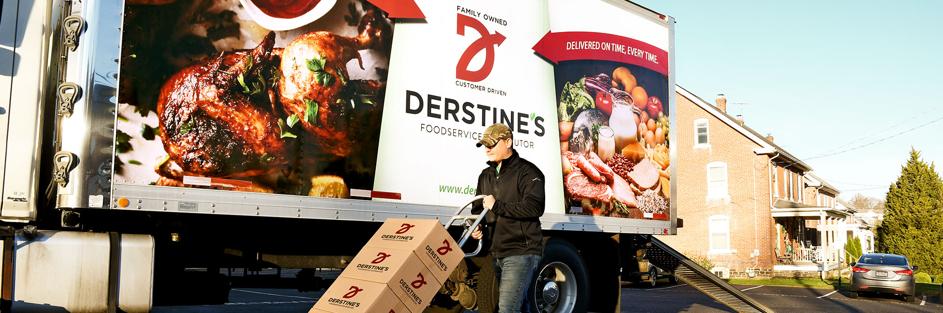 Derstine's truck with man pushing boxes on a truck
